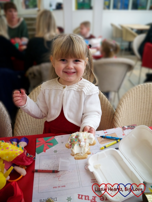 Sophie with her decorated snowman cookie