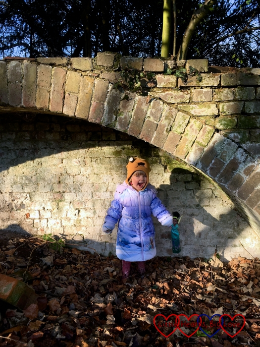 Sophie pretending to be a troll and roaring whilst standing under the bridge