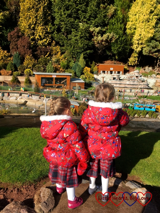 Jessica and Sophie looking at the miniature version of Paignton Zoo
