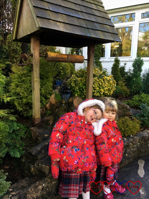 Jessica and Sophie standing by the wishing well at Babbacombe Model Village