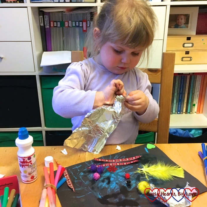 Sophie getting creative with the contents of her box from Children's Art Galleries