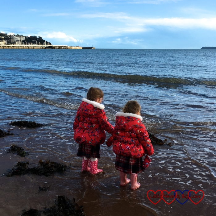 Jessica and Sophie paddling in the sea