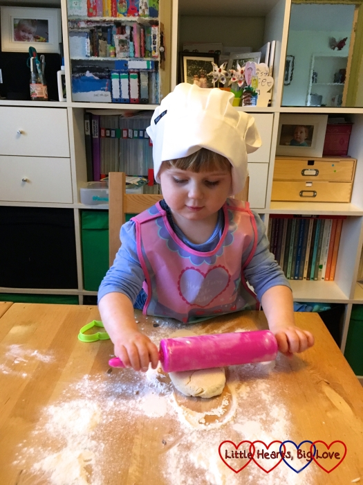 Sophie rolling out the scones whilst wearing her chef's hat