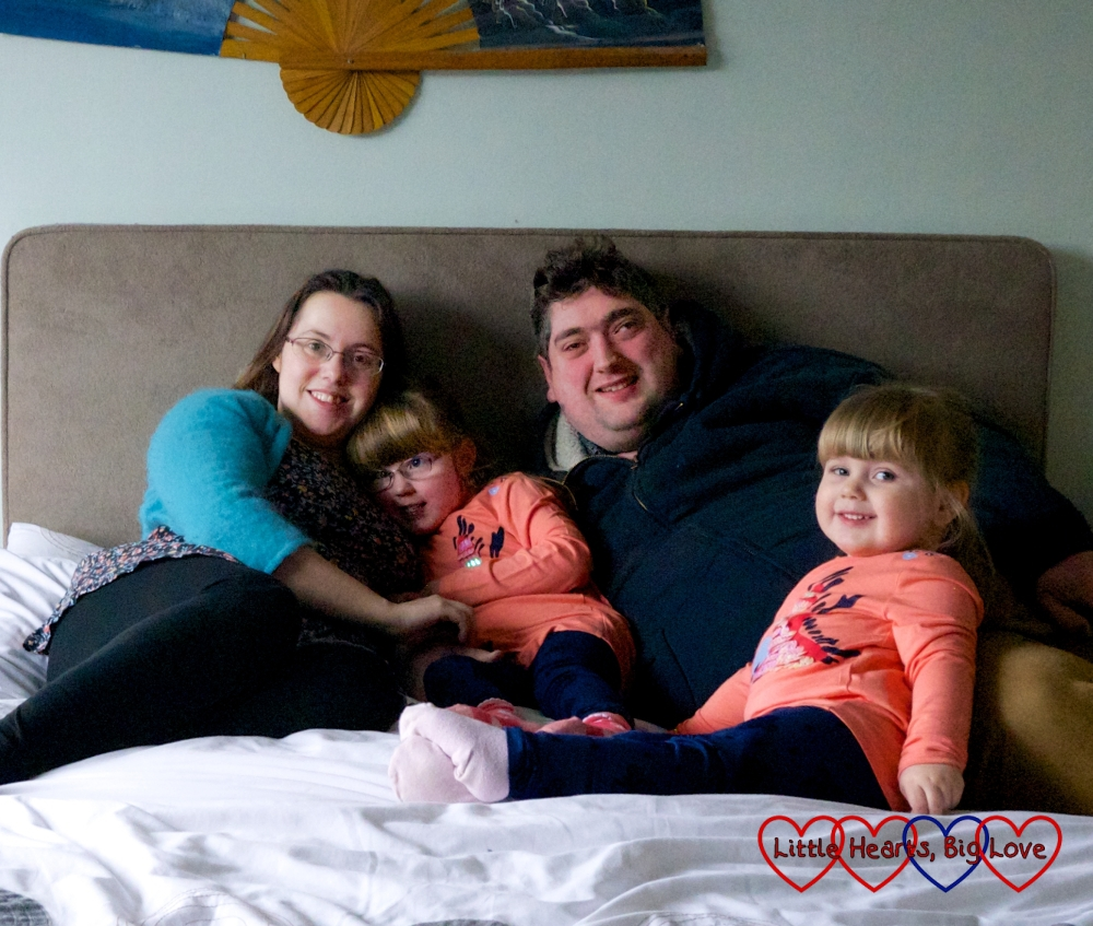 Me, Jessica, hubby and Sophie sitting on the bed