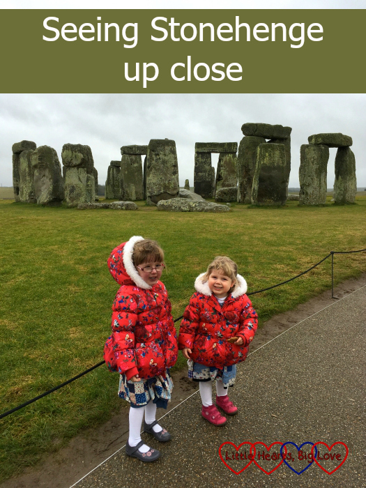 Jessica and Sophie standing near the stones at Stonehenge
