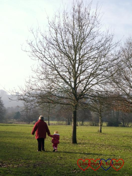 Sophie and Grandma walking across the field