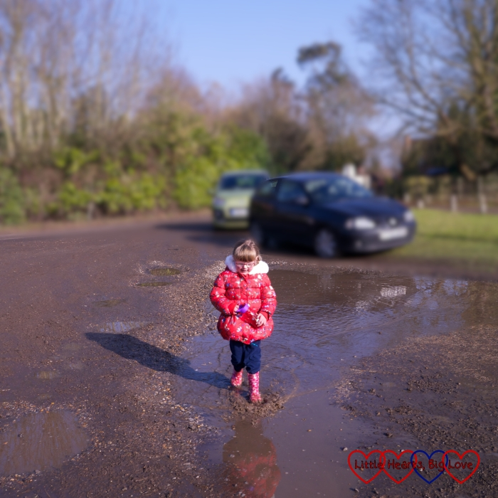 Jessica finds a large puddle to try and clean some of the mud off the wellies