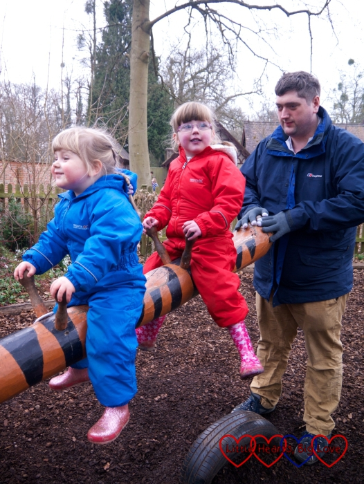Jessica and Sophie on the seesaw at Cliveden with Daddy helping to push it up and down