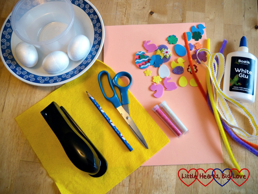 The items you will need: two small bowls, polystyrene eggs, a plate, craft foam, felt, stapler, scissors, glitter, glue, pencil, foam shapes or stickers to decorate