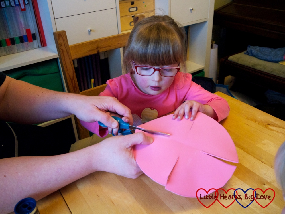 Jessica cutting along the fold lines on the craft foam circle