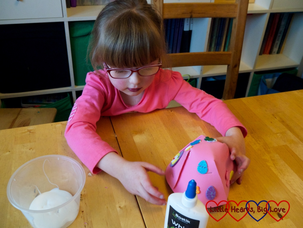 Jessica decorating the basket with foam shapes