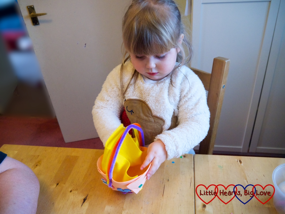 Sophie putting felt in the inside of the basket