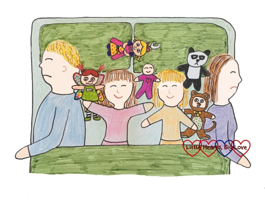 A drawing of me, hubby and the girls asleep in bed with an army of toys joining us too