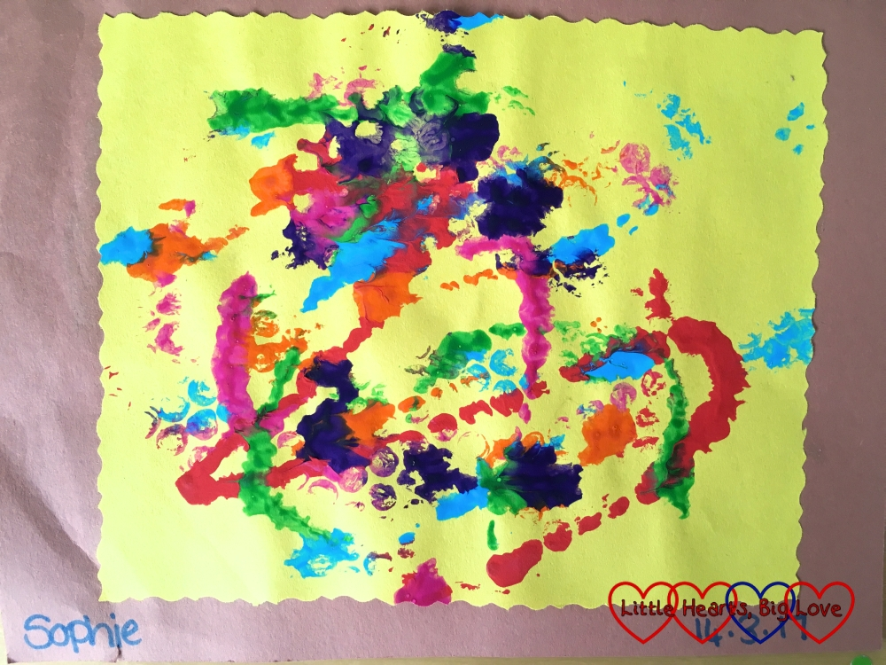 """Sophie's painting that she did at preschool - """"dots and splashes of paint"""""""