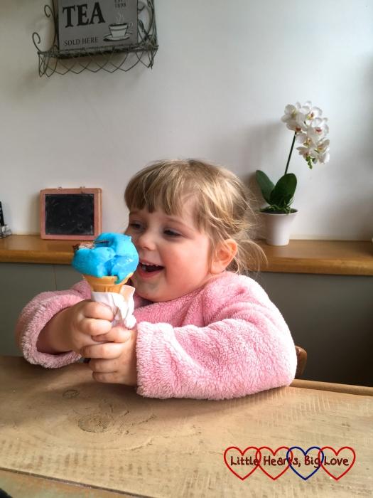 Sophie eating a bubblegum flavoured ice-cream in the cafe at Langley Park