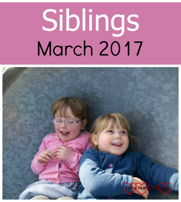 Jessica wearing a pink cardigan lying next to a grinning Sophie in a blue cardigan - Siblings: March 2017