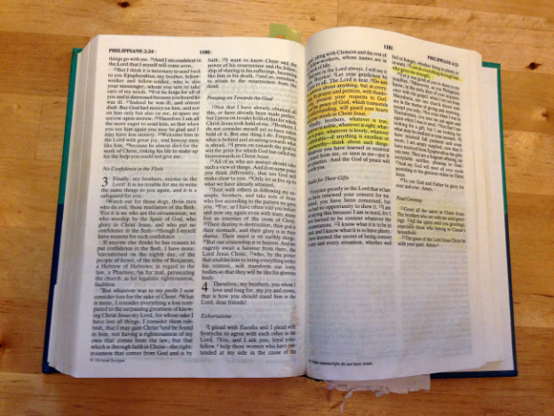 An open Bible with Philippian 4:13 highlighted