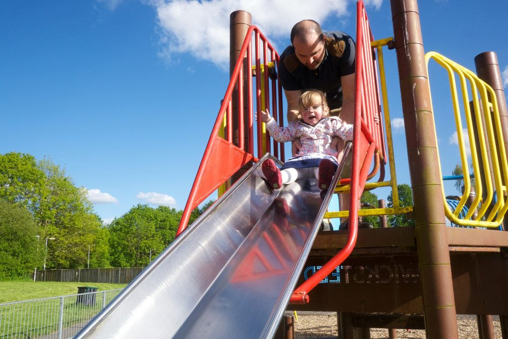 Jessica going down the slide at the park
