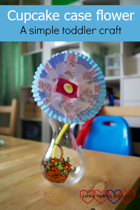 "A flower made from three cupcake cases, tissue paper, pipe cleaner and a button - ""Cupcake case flower - a simple toddler craft"""