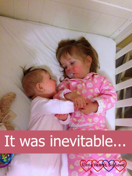 "Jessica and Sophie lying in the cot together with Sophie looking at Jessica - ""It was inevitable..."""