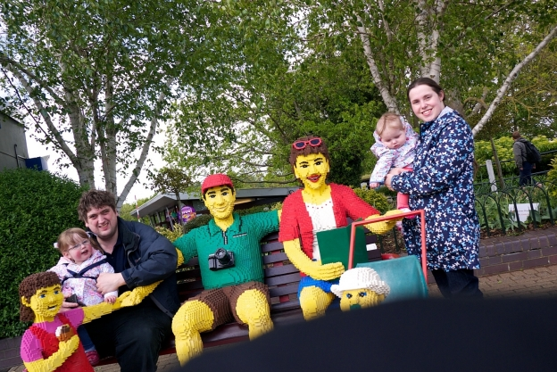 A slightly wonky shot of hubby, Jessica, me and Sophie sitting with some Lego people at Legoland
