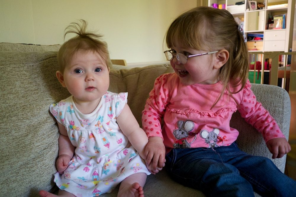 Sophie and Jessica sitting on the sofa together