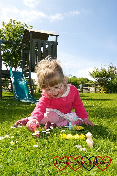 Jessica playing with her In the Night Garden characters in the park