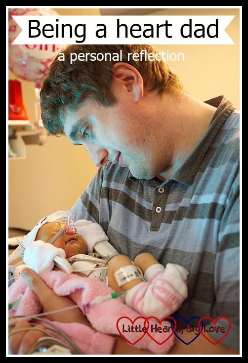 "Hubby holding a newborn Jessica and looking down at her with pride - ""Being a heart dad - a personal reflection"""