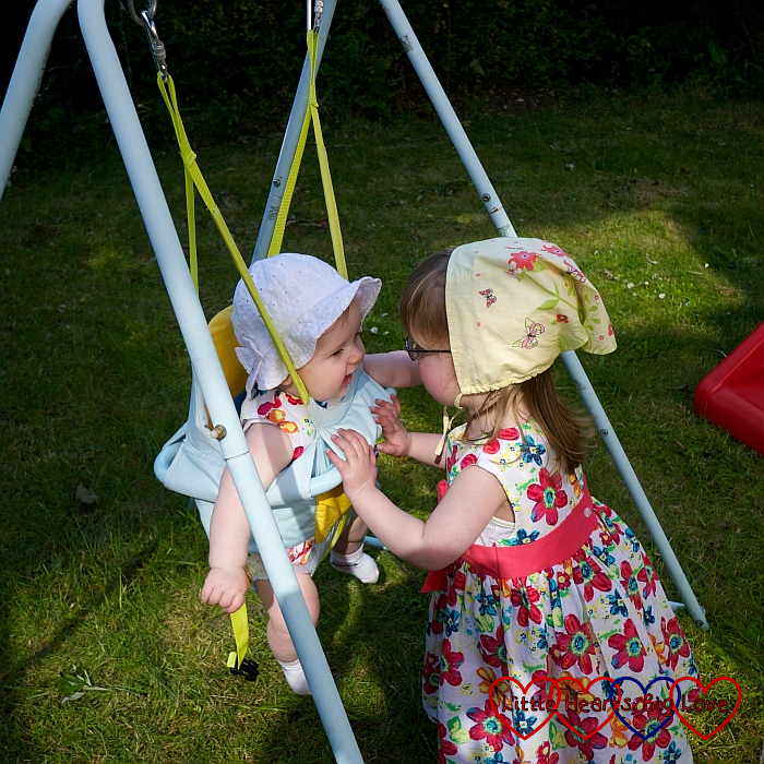 Jessica pushing baby Sophie on a swing