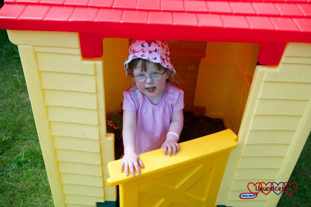Jessica in her playhouse