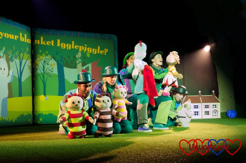 The In the Night Garden performers holding the various characters