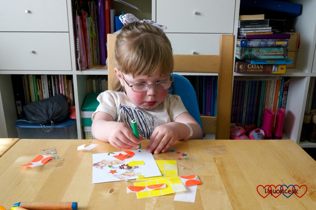 Jessica drawing on her square of cardboard