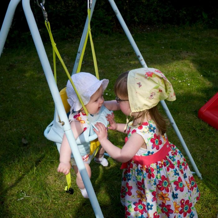 Jessica pushing baby Sophie in the swing