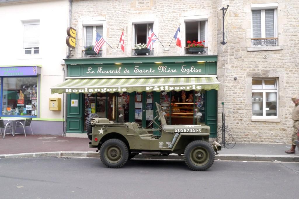 A WW2 army car outside a boulangerie in Sainte Mere Eglise