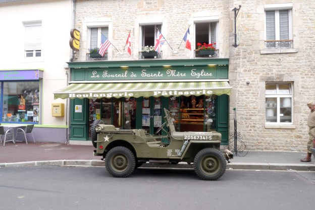 A WW2 army car outside a boulangerie in Sainte Mere Eglise