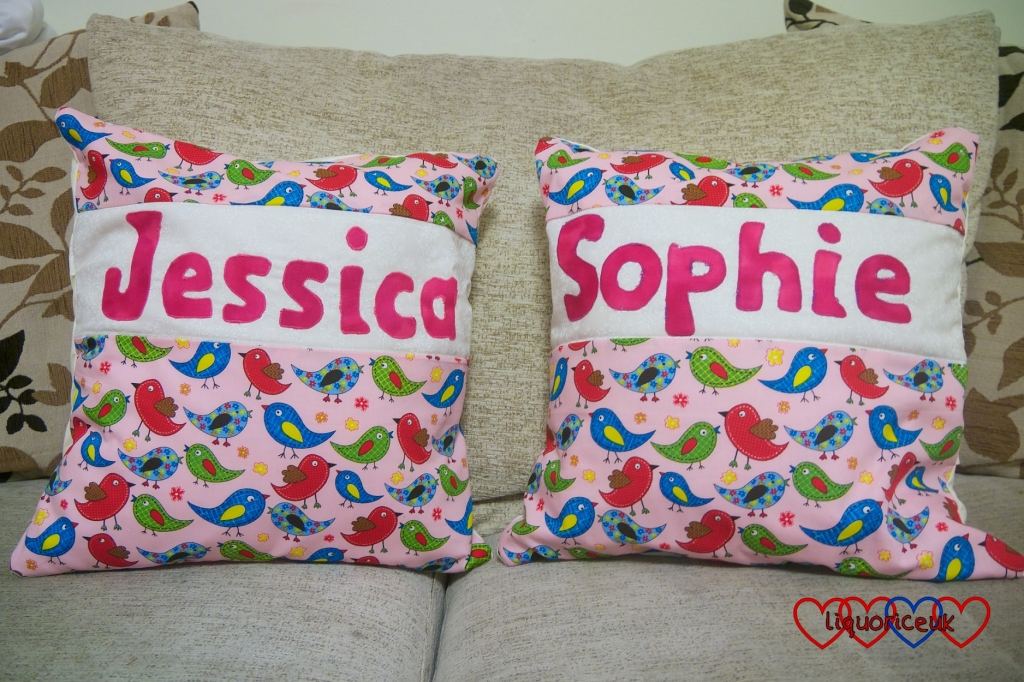 Two cushions with Jessica and Sophie's names on
