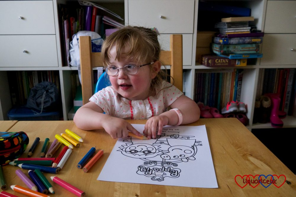 Jessica colouring in the picture of her and Peppa