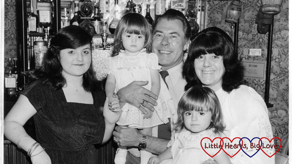 My sister, me, my dad, my mum and my twin in the pub my dad ran in 1982