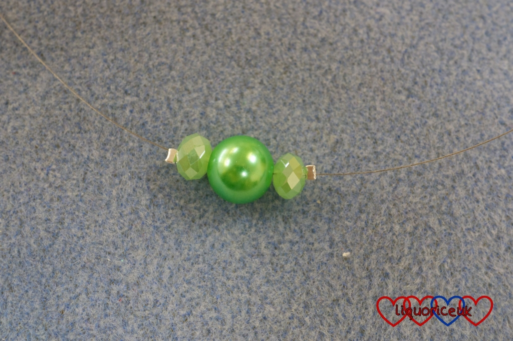 Three beads on beading to make a necklace