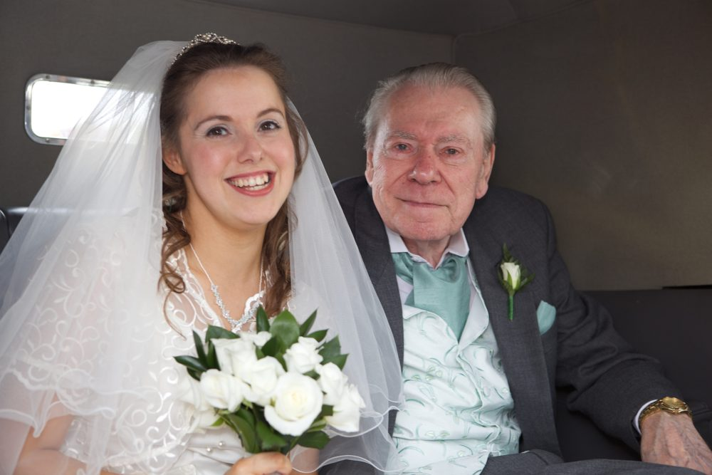 Me and my dad in the car on my wedding day