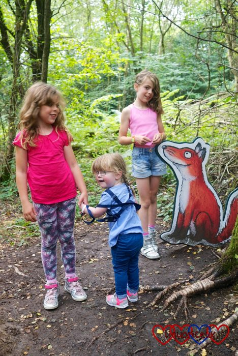 Jessica with her cousins standing by the fox on the Gruffalo trail at Alice Holt Forest
