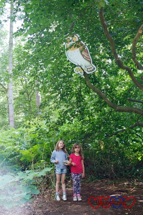 My nieces standing under a tree with Owl from the Gruffalo in the branches