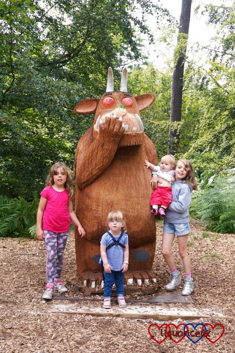 Jessica, Sophie and their cousins standing next to the Gruffalo sculpture at Alice Holt Forest