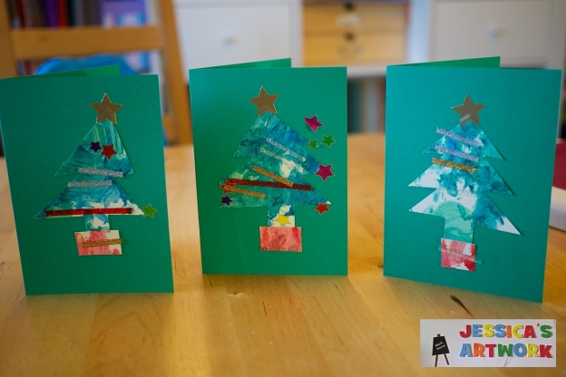 Three Christmas cards with Christmas trees on the front