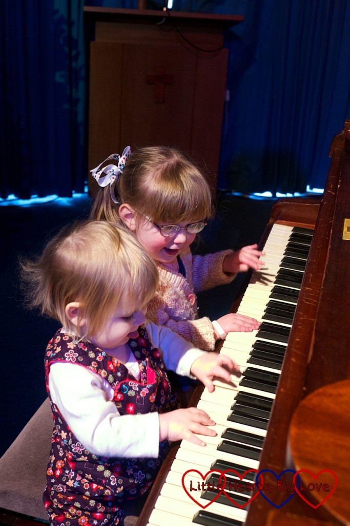 Jessica and Sophie playing the piano together