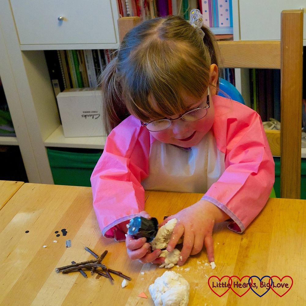 Jessica exploring the texture of the soap before making her snowman
