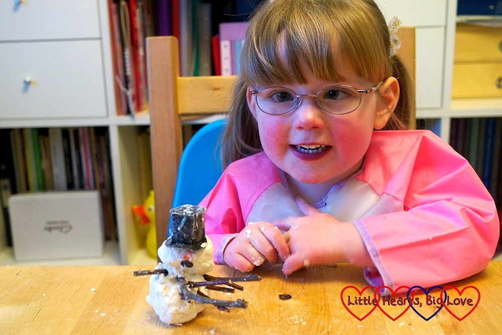 "A very happy Jessica with her finished ""snowman"""