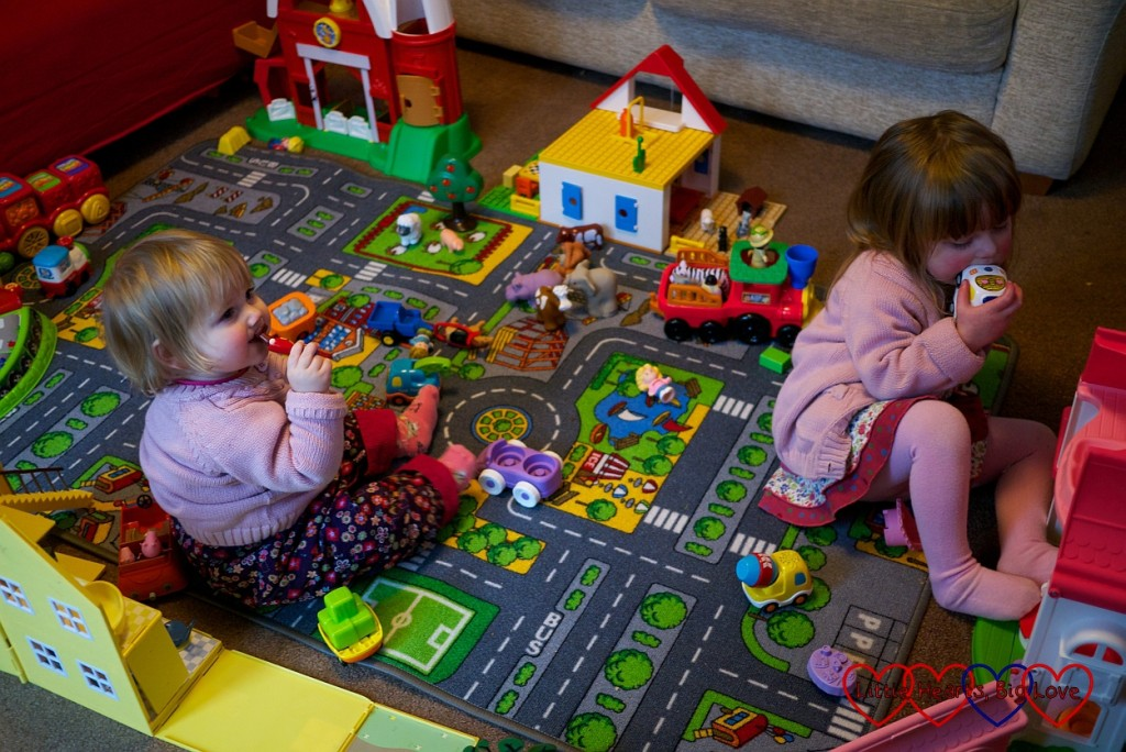 Imaginative play with a village of toys - Little Hearts, Big Love