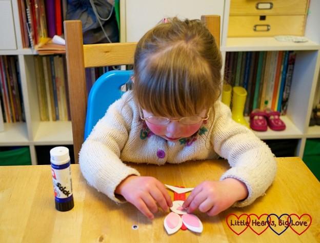 Jessica making a craft-stick rabbit
