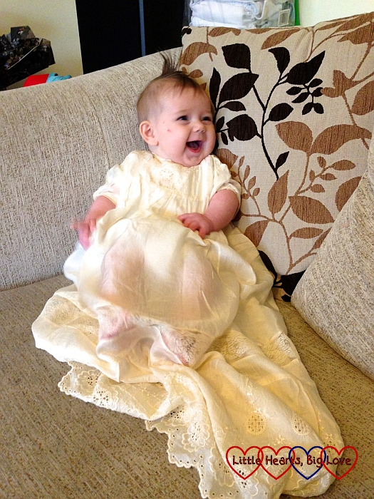 Sophie in her granddad's 80 year old christening gown